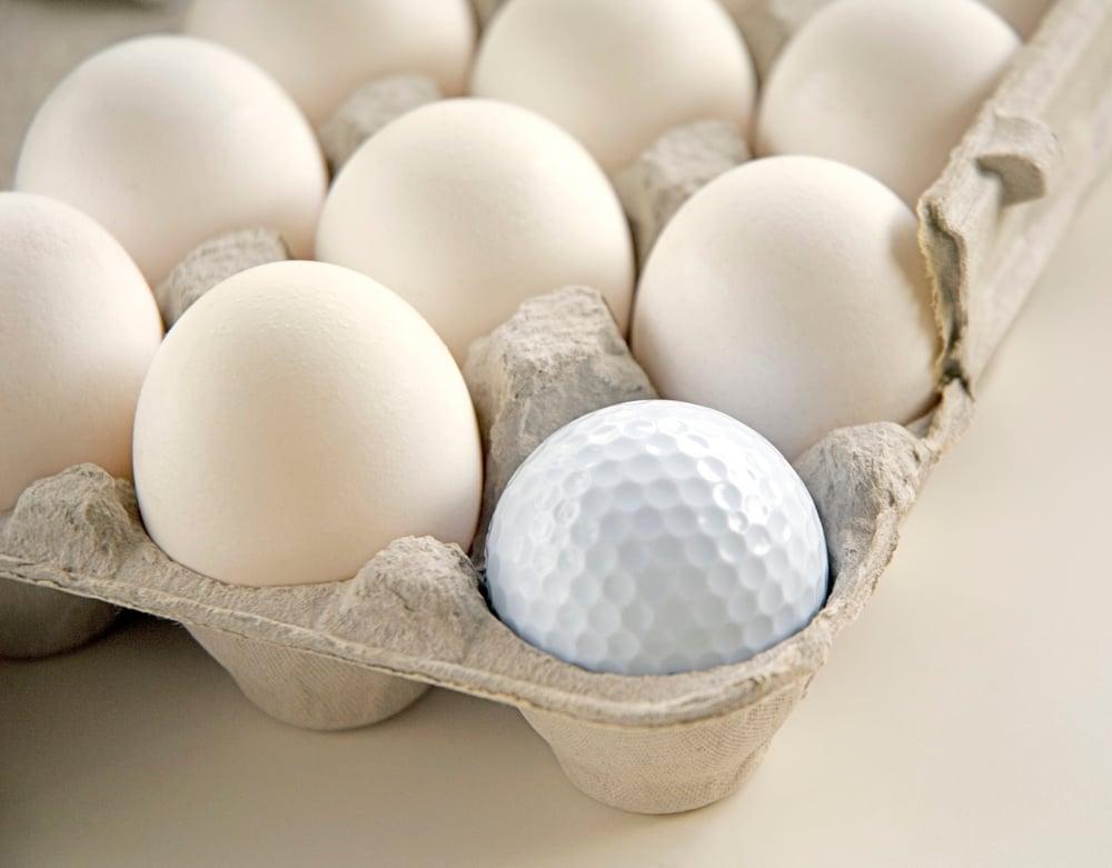 Golf ball in egg carton