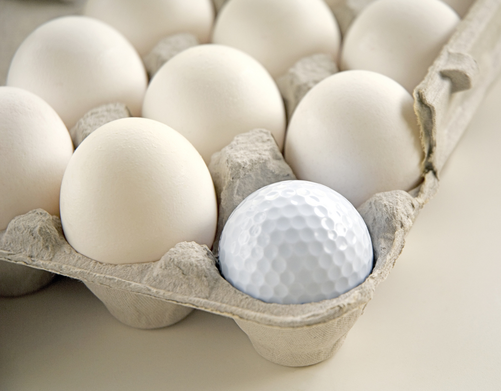 Golf ball in egg carton
